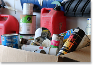 Photo mixed paint cans in cardboard box